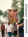 Small photo of People carrying Hindu God Idol Ganesh for Holy Immersion (Ganpati Visharjan) at The Ganges River, 27 Sep 2015, Kanpur, INDIA
