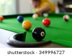 Young Man Playing Pool In A Ba...