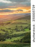 Stock photo beautiful golden light shining on hope valley in derbyshire the peak district uk 350005739