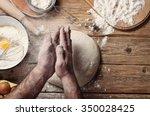 male baker prepares bread. male ...   Shutterstock . vector #350028425