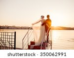 happy couple standing on the...   Shutterstock . vector #350062991