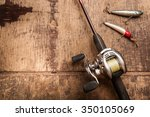 fishing rood and reel on a wood ... | Shutterstock . vector #350105069