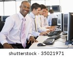 stock trader smiling at camera | Shutterstock . vector #35021971