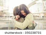 two girls hugging each others... | Shutterstock . vector #350238731