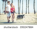 Young Couple With Husky Dog In...