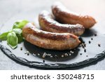 fried domestic sausages on dark ... | Shutterstock . vector #350248715
