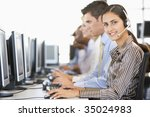stock traders with headsets at... | Shutterstock . vector #35024983