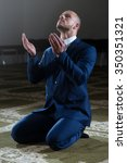 Small photo of Businessman Muslim Making Traditional Prayer To God Allah In The Mosque