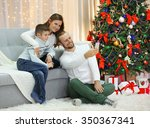 happy family making photo in... | Shutterstock . vector #350367341