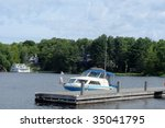 Boat and boathouse - stock photo