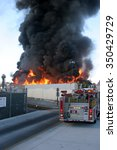 Small photo of HARBOR GATEWAY, CALIFORNIA- DECEMBER 12, 2015: Fire erupts at recycling yard in Harbor Gateway. Flames and Acrid Black Smoke fill the air during a fire in Harbor Gateway, California Dec. 12, 2015
