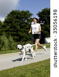 Stock photo woman running with dog 35056198