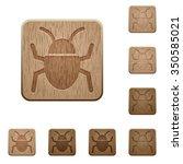 set of carved wooden bug...