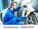 auto mechanic worker applying washing car body preparing for painting at automobile repair and renew service station - stock photo