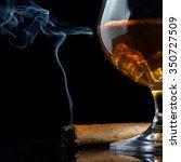 cognac glass with cigar on... | Shutterstock . vector #350727509