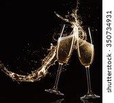 glasses of champagne with splash | Shutterstock . vector #350734931