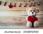 Teddy Bear Holding A Heart...