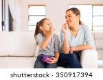 happy mother and daughter... | Shutterstock . vector #350917394