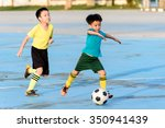 Young Asian Boy Play Football...