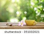 yellow coffee cup with flower... | Shutterstock . vector #351032021