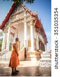 monk in front of temple | Shutterstock . vector #351035354
