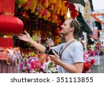 tourist traveler with camera in ... | Shutterstock . vector #351113855