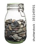 Canned Pebble. Glass Jar With...