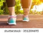 female athlete runner touching... | Shutterstock . vector #351204695