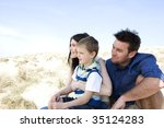 a family sitting together on... | Shutterstock . vector #35124283