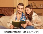 young cute couple reading... | Shutterstock . vector #351274244