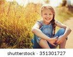 happy child girl in jeans... | Shutterstock . vector #351301727