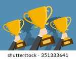 hands holding winner's cups in... | Shutterstock .eps vector #351333641