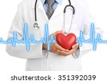 medical doctor holding heart | Shutterstock . vector #351392039