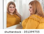 Happy Overweight Woman Looking...