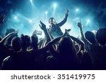 dj in front of crowd | Shutterstock . vector #351419975