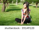 the girl sitting on a grass | Shutterstock . vector #35149120