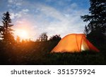 a tent lit up at dusk  | Shutterstock . vector #351575924