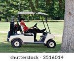 A Male Golfer In A Golf Cart...