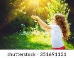 little girl holding young green ... | Shutterstock . vector #351691121