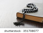 holy quran with beads over... | Shutterstock . vector #351708077