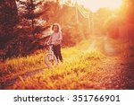 child girl riding bicycle on... | Shutterstock . vector #351766901