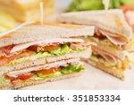 A Club Sandwich On A Rustic...
