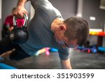 young man lifting dumbbell and... | Shutterstock . vector #351903599