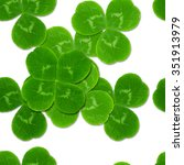 Small photo of leaves clover shamrock quatrefoil seamless pattern St. Patrick white background Irish Culture
