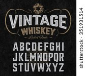 Stock vector vintage whiskey label font with sample design ideal for any design in vintage style vector 351931514