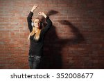 young woman standing at the...   Shutterstock . vector #352008677