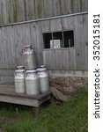 Small photo of Milk cans on a loading platform ready for pick up from an Amish farm in Kishacoquillas Valley in Mifflin County, PA.
