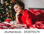 young woman in a red knitted... | Shutterstock . vector #352070174