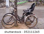bicycle with a baby seat parked ...   Shutterstock . vector #352111265