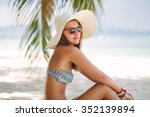 beautiful woman sit on the sand ... | Shutterstock . vector #352139894
